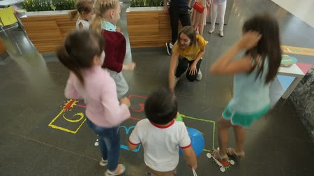 numerals : Kids having fun playing hopscotch