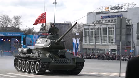 coalition : The tank is traveling around the city square.