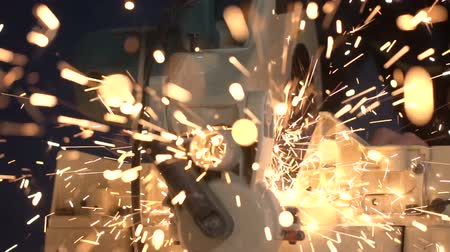 kaynakçı : During Welding of Metal Pipe by Working Closeup, Sparks Fly to the Camera Slowmo