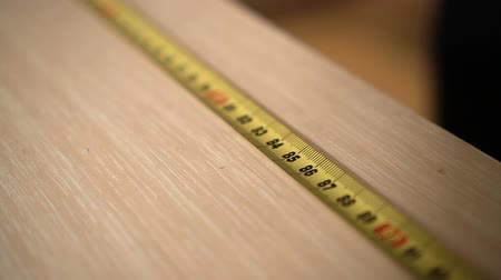 instrument maker : Furniture Maker at Factory Marks Yellow Ruler Closeup with Pencil Mark Number85