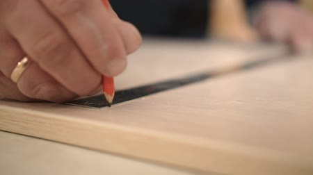 ruletka : Furniture Maker at Plant Marks an Iron Ruler Close up with a Pencil Slow Motion