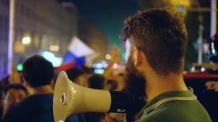 unrest : A young guy comes out from the loudspeaker for the crowd against the current government. the guy watches and thinks how goes maidan. In the night city the activist conducts a strike. Stock Footage