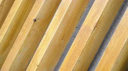 camera rotation : Wooden beam rotates. Wood planks spinning close up. Background of the sticks is swirling closeup. Building facades of wood background. Exterior repair. Place for your text. Space for your logo 4k.