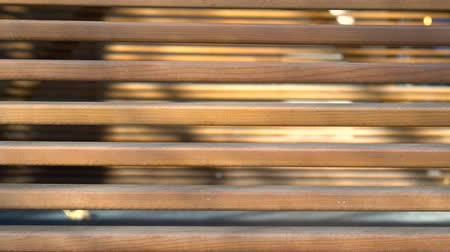 camera rotation : Wooden beam panning. Wood planks vertical panoramic close up. Background of jalousie macro. Building facades of wood background closeup. Exterior repair. Place for your text. Space for your logo 4k. Stock Footage