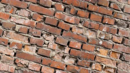 destruído : Old brick wall rotation closeup 4k. The rotting and destruction of the red house close up. Clear place for your isolated text. Empty space for your title copy space. Copyspace logo to blank design.