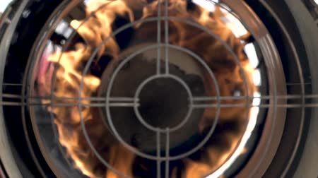 The heat gun located right in the center of frame. The fire is burning bright. This beautiful composition resembles airplane turbine. You feel the danger and passion of fire. Close-up enhances effect Archivo de Video