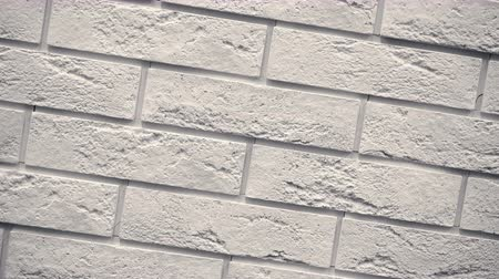 Rotation of white decorative bricks for home. Brickwork background. Figure block. Clear place for your isolated text pattern. Empty space for your title copy space. Copyspace logo to blank design. Стоковые видеозаписи
