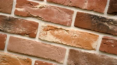 шов : Rotation of red decorative brick with cracks. Brickwork background. Figure block. Clear place for your isolated text pattern. Empty space for your title copy space. Copyspace logo to blank design.