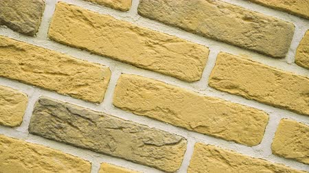 Rotation of yellow decorative brick for home. Brickwork background. Figure block. Clear place for your isolated text pattern. Empty space for your title copy space. Copyspace logo to blank design.