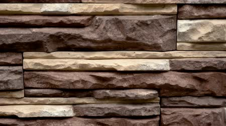 Panorama of decorative stone. Move up the granite to the house. Wall of stone. Clear place for your isolated text pattern. Empty space for your title copy space. Copyspace logo to blank design. Стоковые видеозаписи