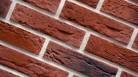 Rotation of red decorative brick with cracks. Brickwork background. Figure block. Clear place for your isolated text pattern. Empty space for your title copy space. Copyspace logo to blank design.