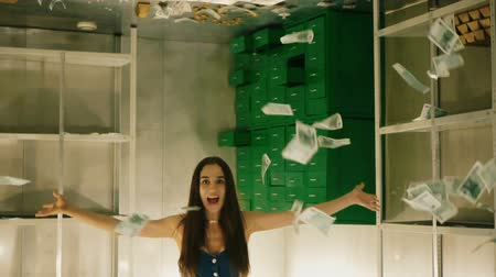cash free : Girl in slowmotion throws lot of money banknotes. Many dollars fly in air above your head rapid. happy woman rejoices in great wealth money. Many dollars and euro scattered in bank box. Slow motion. Stock Footage