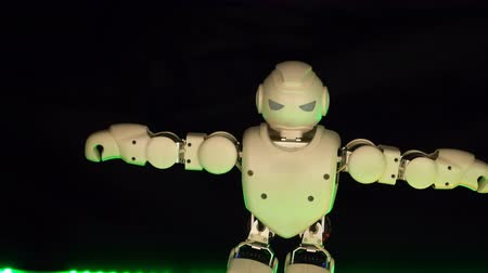 android : interesting biotic toy body mini dance floor chroma ray. Small toy robot closeup actively quickly dancing on catwalk kid show. white bionic like disco dancer moving around stage child black background Stock Footage