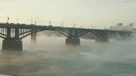 nowa zelandia : In a fabulous Russian city there is winter fog. The bridge holds tightly over the river. A magical country with beautiful scenery is represented by a curious look. Bridge seems to soar above the river