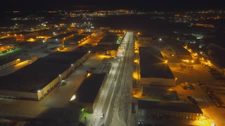 container terminal : In the night city there are several warehouses and dumps for spare parts of old aircraft. Shooting from quadrocopter. The landscape is breathtaking. Lights of night city beautifully complement picture