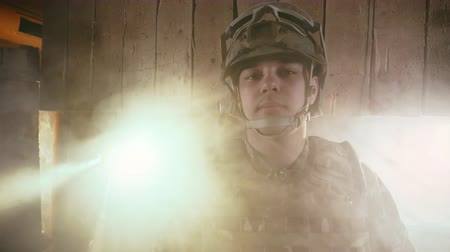 охранять : American military is looking at the camera close up. Portrait of a soldier in ahelmet in America. US war. Smoke from the explosion in air. Army usa. Caucasion patriot united state. Honor and armor 4k.