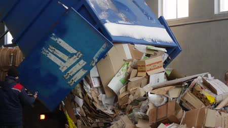 reprocessing : Truck brought the waste paper to the garbage processing plant. Unloading of recyclable materials in the warehouse of the waste processing plant. Stock Footage