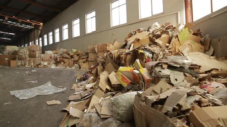 reprocessing : Warehouses with recyclable materials at the garbage processing factory. Huge pile of different paper pieces, closeup view in motion. Large warehouse of waste paper in a factory.