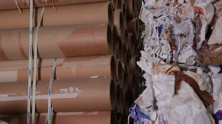 reprocessing : Waste paper. Material Recovery Facility. Sorted cardboard waste ready for reprocessing. Processing of secondary resources. Paper recycling. Sorted cardboard waste ready for reprocessing.