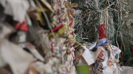 reprocessing : Garbage truck unloads the waste paper at the garbage recycling plant. Close-up shot. Big Factory For Recycling Paper and Carboard. Processing of secondary resources. Paper recycling. Large enterprise.