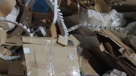 reprocessing : Waste paper. Large warehouse of waste paper in a factory. Huge pile of different paper pieces, closeup view in motion. Stock Footage