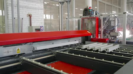 chloride : Cutting of plastic and metal profiles on an automated machine. A modern spacious workshop producing plastic and metal windows and doors. PVC windows automatic line machine cutting sections Stock Footage