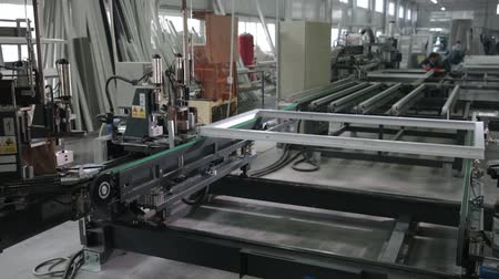 solder : Automatic line machine for sticking together PVC sections of windows and doors in a single frame. Modern workshop for production of plastic and metal windows and doors. Production of plastic windows.