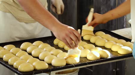 scones : Glazing buns. Buns on the baking tray are greased with oil. Before baking them on fire, you need to coat them with sunflower oil with a brush. It makes the pies look golden. Smearing buns with glaze.