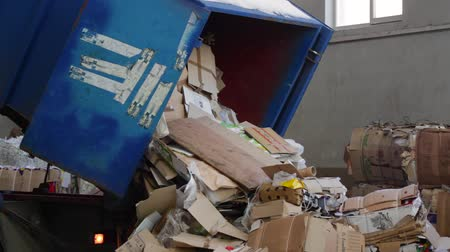 reprocessing : Logistics at the waste processing plant. Truck brought the waste paper to the garbage processing plant. Unloading of recyclable materials in the warehouse of the waste processing plant. Stock Footage