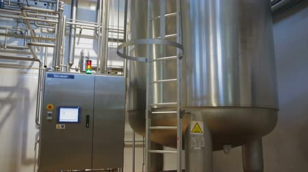 yoghurt : Kiev Region, Ukraine - Februry 2017: Factory equipment controllers. Modern complex industrial industrial pasteurizing and cooling equipment. Huge tanks for storing and fermenting milk.