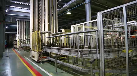 winemaking : Wine bottles moving along a conveyor belt in a wine bottling factory. Bottle manufacturing technology in industrial factory. Glass recycling. Movement bottles. Production of glass bottles. Stock Footage