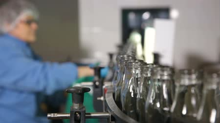 juice jar : Quality control of glass containers in the factory for the production of baby food. Workers controls the quality and purity of glass bottles in a dairy factory. Stock Footage