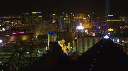 blackjack : Las Vegas, USA - April 2018: Aerial view of the Las Vegas strip at night. Night view of Las Vegas from the hotel window. Stock Footage