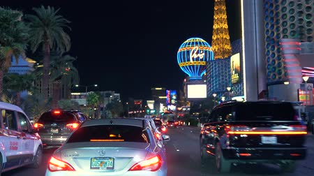 vago : Las Vegas strip driving shot at night. Auto rides down the main street in Las Vegas. POV Driving in Las Vegas - 4K. Stock Footage