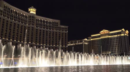 bellagio hotel : Las Vegas, Nevada - April 2018: Bellagio water fountain show in Las Vegas with original ambient sound. Fountains Bellagio Hotel and Casino in Las Vegas. Musical Fountains. 4k video with ambient sound.