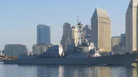 navy pier : Warship sails against the background of San Diegos downtown in the morning at dawn. Stock Footage