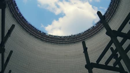 destruído : Cooling tower in exclusive zone. Chernobyl Cooling tower round construction, bottom-up view of the neck of tower. Cooling tower of Chernobyl Nuclear Power Station, Chernobyl Exclusion Zone, Ukraine.