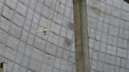chernobyl : Drone flies on the territory of Chernobyl zone in Pripyat. Drone is involved in the construction of industrial buildings. Abandoned construction of a cooling tower near Chernobyl nuclear power plant.