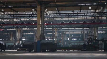 reinforced : Conveyor with tires at factory. Tyres production. Moving conveyor transfers formed rubber tires along large manufacturing plant workshop. Manufacture of tires. Tyre production machine conveyor.