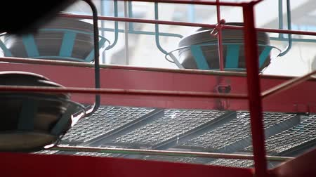 tread : Conveyor with tires at factory. Tires production. Moving conveyor transfers formed rubber tires along large manufacturing plant workshop. Manufacture of automobile tyres. Tyre factory. Stock Footage