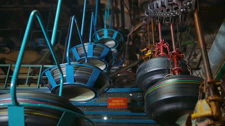 mold : Tire blanks move on the conveyor through the shop. Conveyor with tires at factory. Manufacture of tires. Tyre production machine conveyor. Tires production. Transport system in a tire factory. Stock Footage