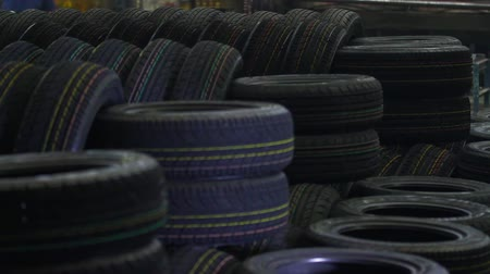 koruyucu : Tires production factory. New cars tires stacking up at workshop. Car tyres at store. Protector surface texture.