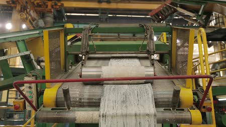 componentes : Recycling rubber in the chemical industry. Pressing rubber for tyres production. Tire production. Rubber tape on a rolling machine. Rubber band before molding at a tire factory. Stock Footage