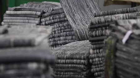 нефтехимический : Rubber band before molding at a tire factory. Rubber tape on a large tire factory close-up. Recycling rubber in a large enterprise. Recycling and waste of the chemical industry. Refinery waste.