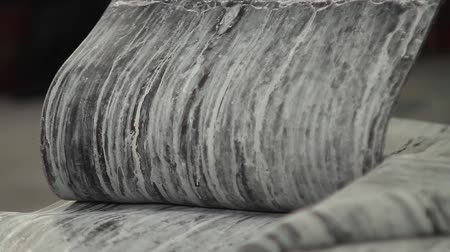 reciclado : Rubber tape on a large tire factory close up. Recycling rubber in a large enterprise. Recycling and preparation of rubber mixture for production of automobile tires. Tyre production machine conveyor. Stock Footage