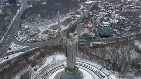 Aerial view of Monument Motherland in Kiev, Ukraine. Kiev city is the capital of Ukraine in winter. Drone footage Aerial view of the Motherland Monument in Kiev Kyiv, Ukraine. Homeland Mother Kiev. Stock Footage