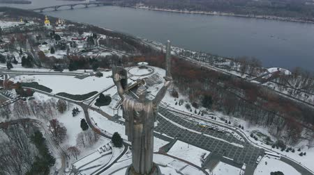 Monument of Motherland Mother in Kiev at winter. Kiev City - the capital of Ukraine. Kyiv. Mother Motherland. The monument is located on the banks of Dnieper River. Kiev, Ukraine Aerial view. Stock Footage