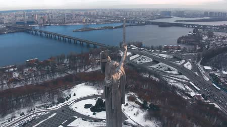 4K Aerial. Capital of Ukraine, Kyiv city . Mother Motherland Soviet time monument. Rear view, flyby. Monument of Motherland Mother in Kiev, winter. Drone footage Aerial view of the Motherland Monument