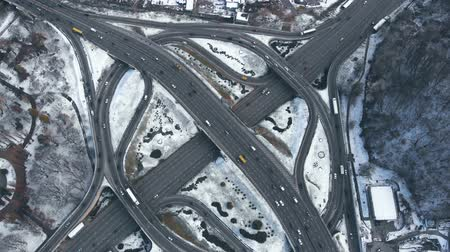 Road interchange in winter aerial view. Road junction with heavy traffic in Kyiv, Ukraine. View from above. Aerial view, winter time. Highway Circle Intersection. Aerial View, winter time.