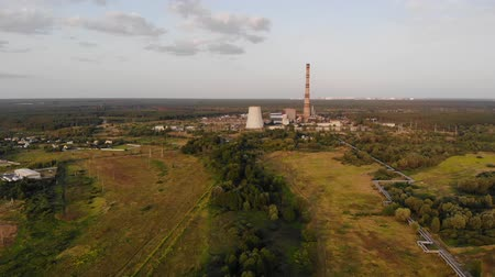 chp : Thermal power plant aggregate with high pipes. Aerial view of energy power station area with industrial buildings. Industrial area heating station in developed city. Aerial view thermal power plant. Stock Footage